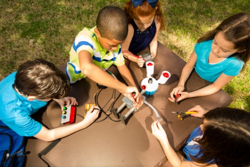 Picture of kids playing with robot
